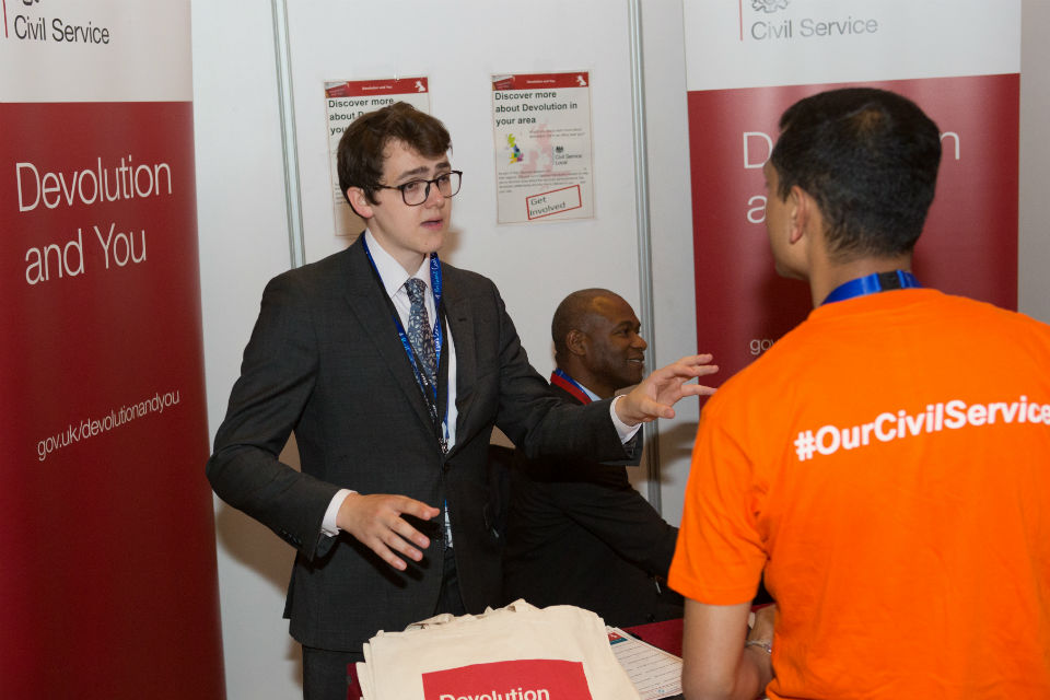 Man talking to another man at an exhibition stand