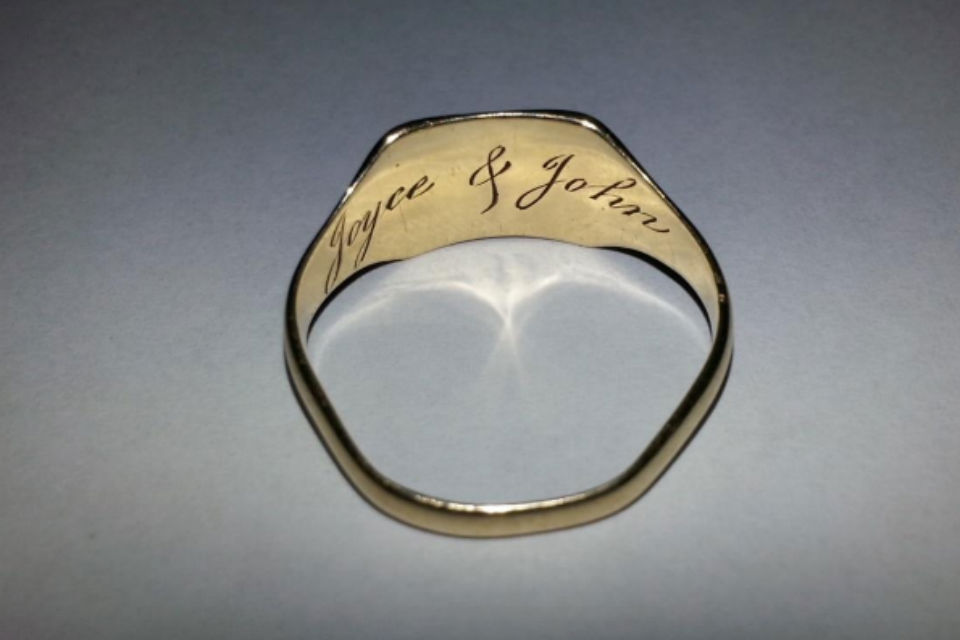 Wedding ring with inscription on reverse