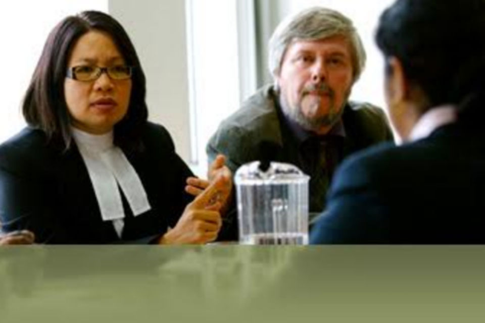 Lawyer in discussion with two others at table