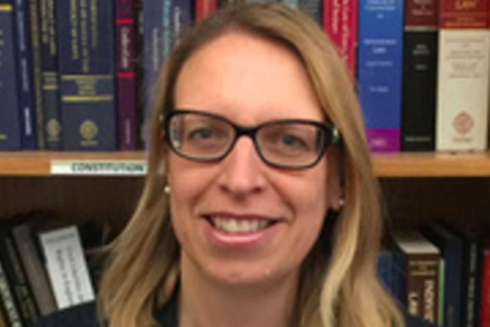 Head shot of Elizabeth Gardiner with glasses