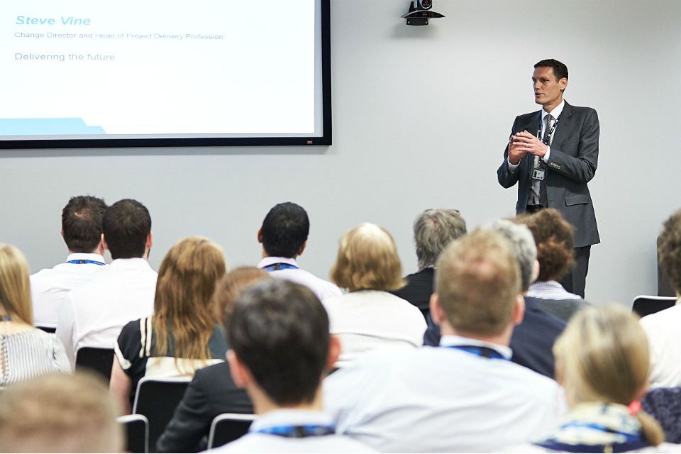 Man speaking to audience at conference