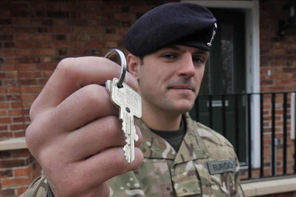 Soldier with keys to home - taken from Armed Forces Covenant Annual Report 2017