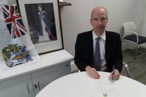 Man signing official document