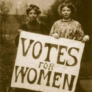 Sepia photograph of two suffragettes with banner