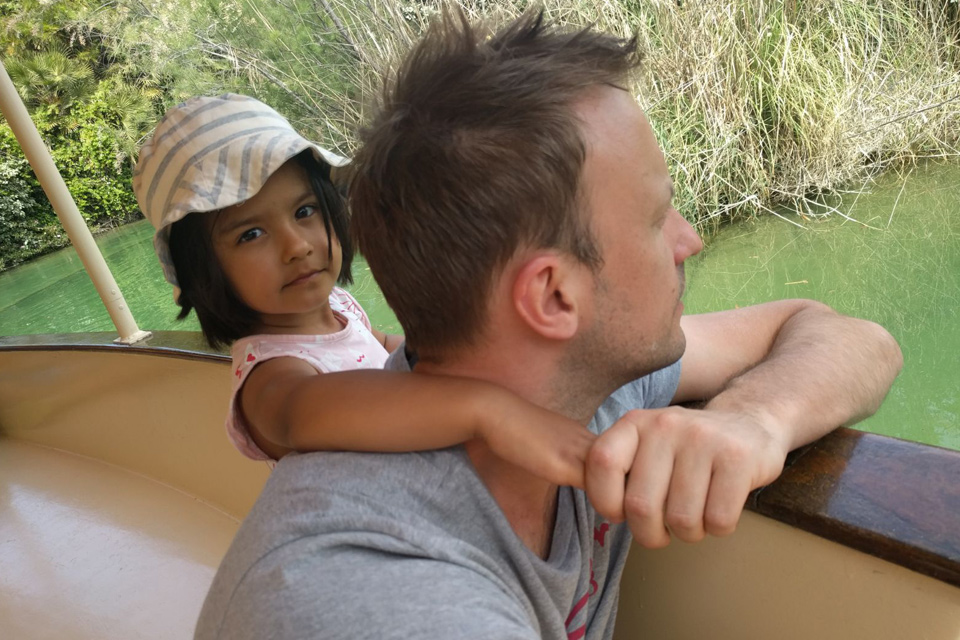 Father and young daughter on river boat