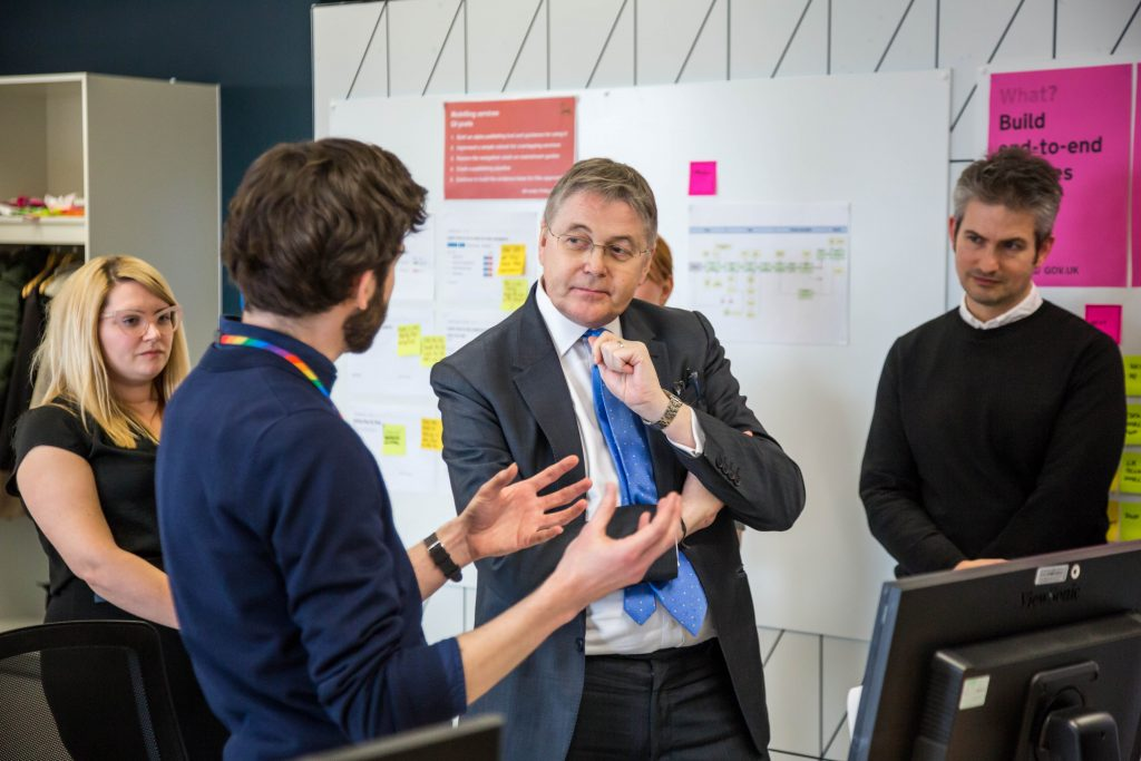 Sir Jeremy Heywood during his visit to GDS offices, talking to staff