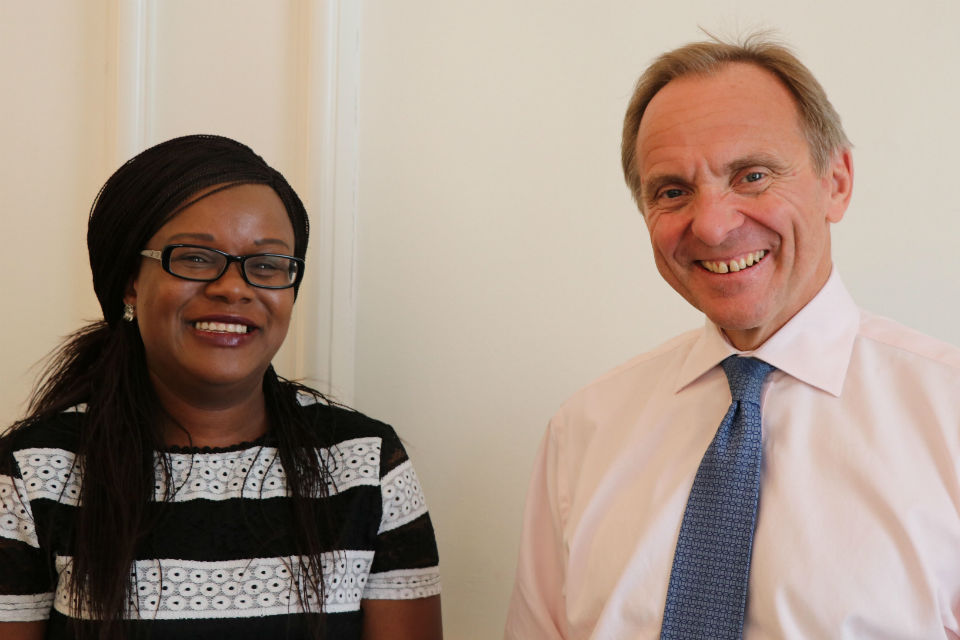 Bernadette Thompson and John Manzoni standing side by side, smiling to the camera.