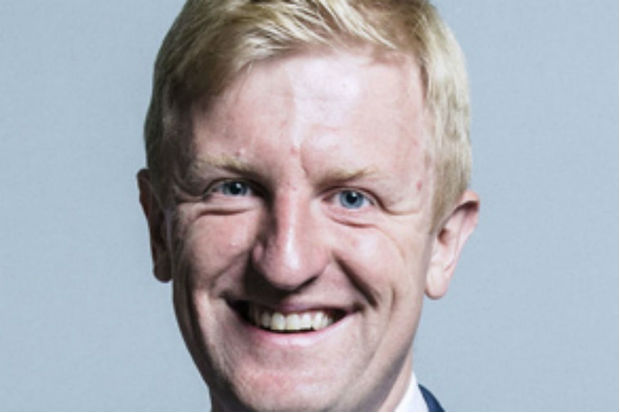 Head shot of Minister Oliver Dowden