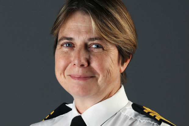 Head and shoulders photo of Royal Navy Commander Kay Hallsworth, who lives with the condition ME