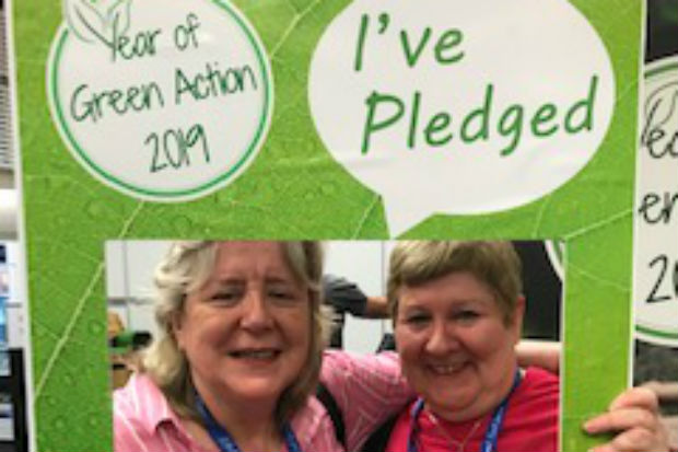 Two women framed by a Year of Green Action 2019 banner with the legend, 'I've pledged'