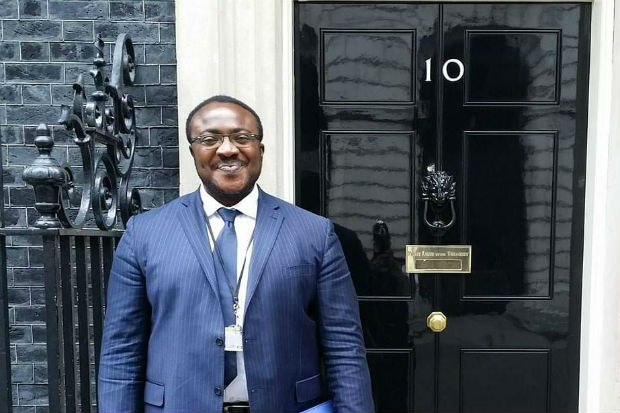 Augustine ('Austin') Entonu outside the door to No. 10 Downing Street