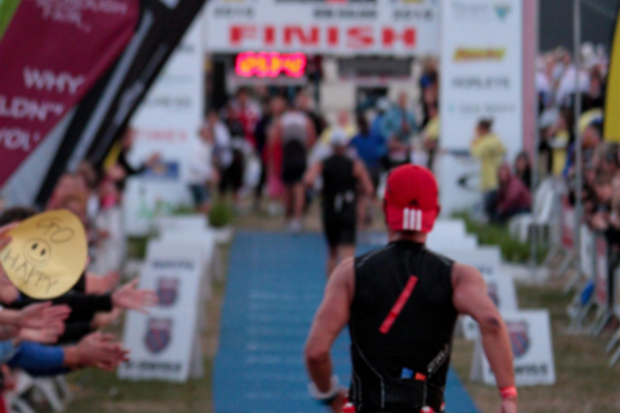 Michael approaching the finish line in an Ironman race