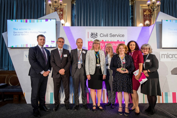 Ben Merrick with the winners of the Championing Disability Award at the Civil Service Diversity and Inclusion Awards 2019