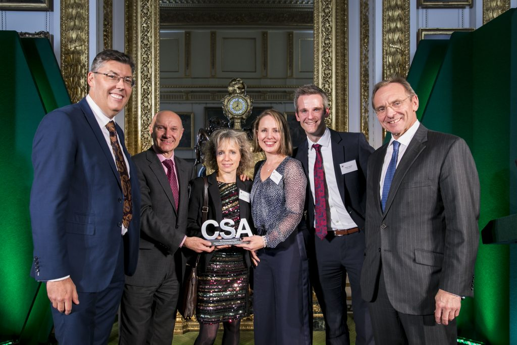 The DHSC winners of the Commercial Award, with award presenter John Manzoni, Chief Executive of the Civil Service & Permanent Secretary for the Cabinet Office