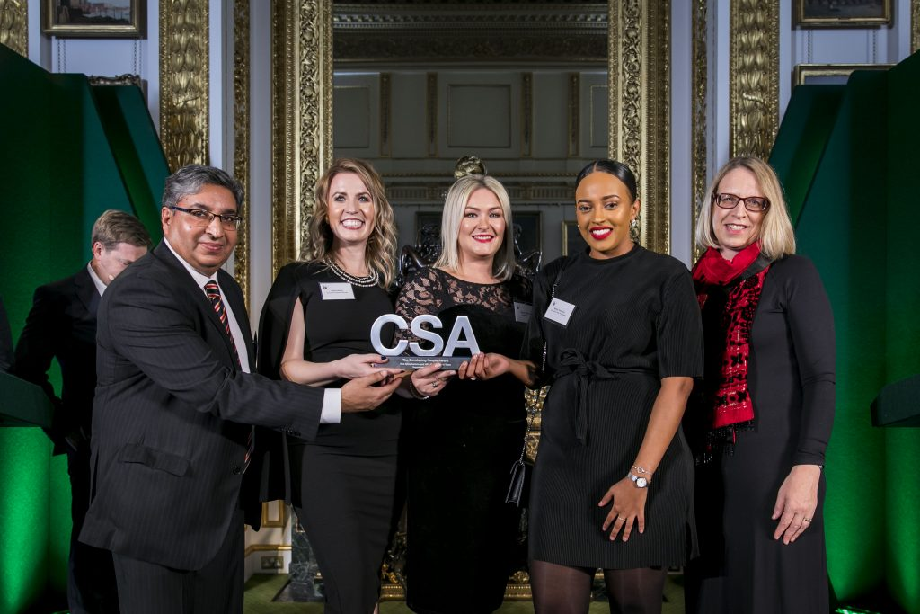 The Care Leaver Policy Team winners of the Developing People Award, with award presenter Elizabeth Gardiner (right), Permanent Secretary of the Government in Parliament Group in the Cabinet Office