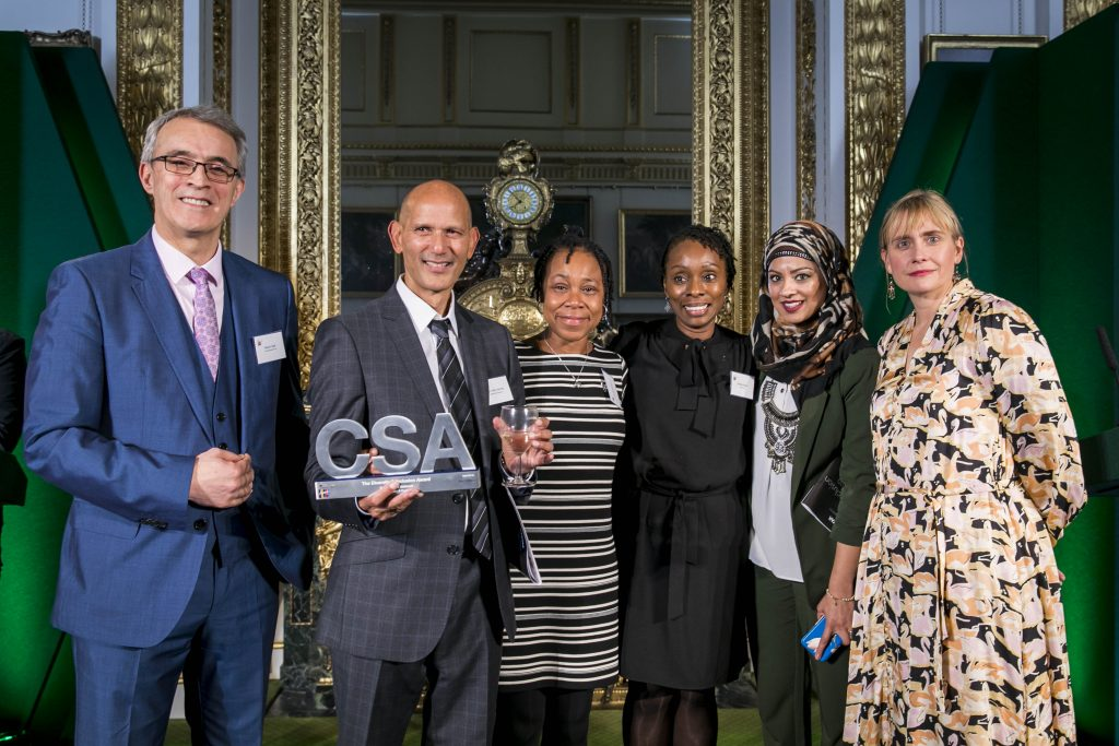 The HMRC winners of the Diversity & Inclusion Award, with award presenter Sarah Healey, Permanent Secretary for the Department for Digital, Culture, Media and Sport