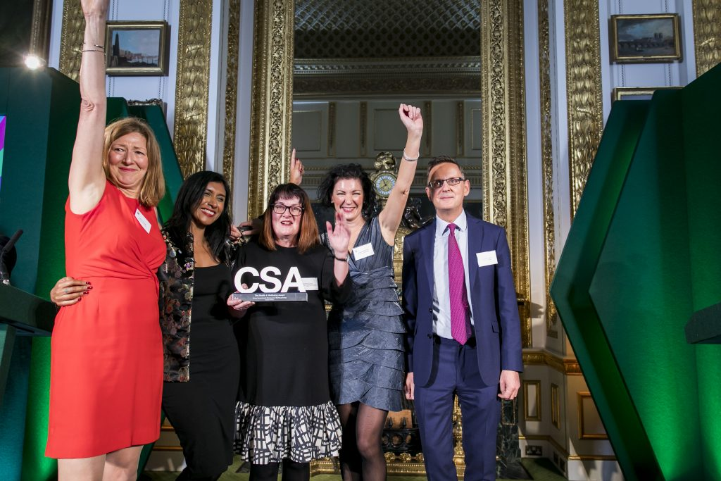 The Cabinet Office winners of the Health & Wellbeing Award, with award presenter Jonathan Jones, HM Procurator General, Treasury Solicitor and Head of the Government Legal Service
