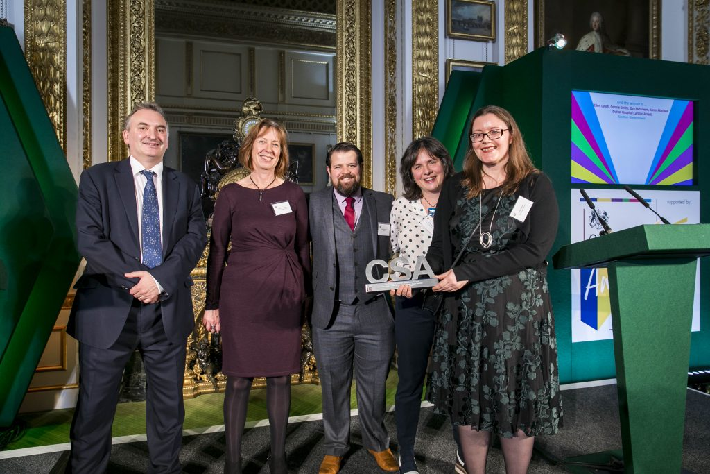 The Scottish Government winners of the Policy & Use of Evidence Award, with award presenter Sir Chris Wormald, Permanent Secretary, Department of Health & Social Care