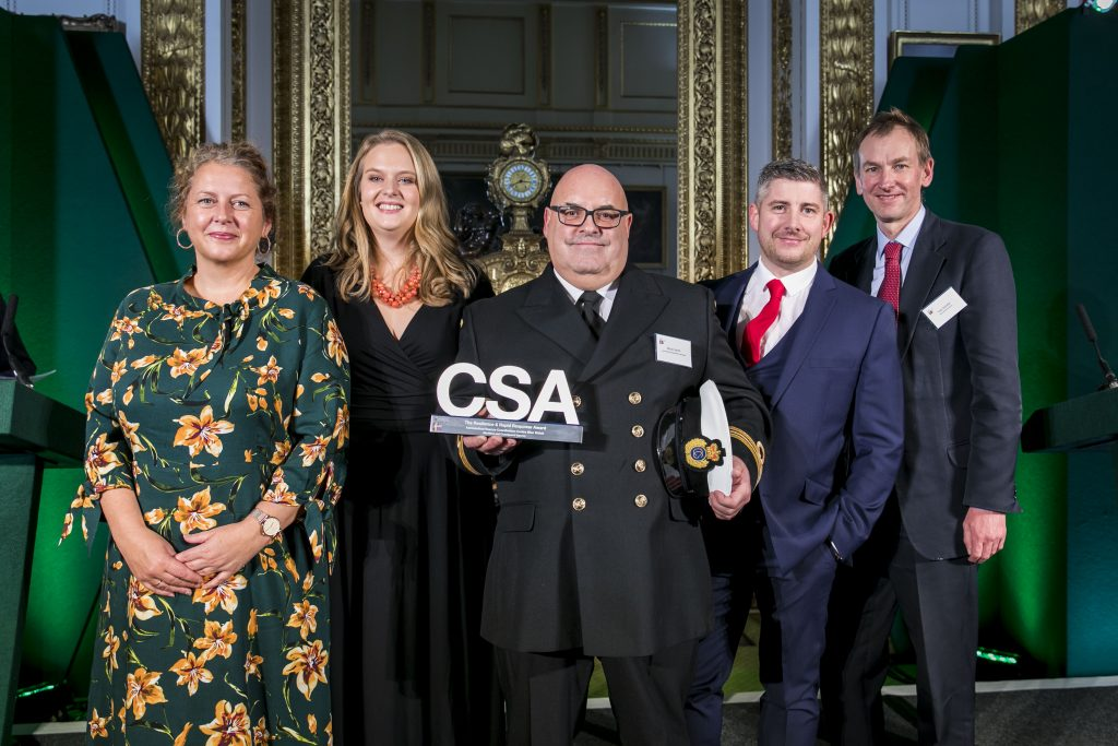 The Maritime & Coastguard Agency winners of the Resilience & Rapid Response Award, with award presenter Sir Tom Scholar, Permanent Secretary for HM Treasury