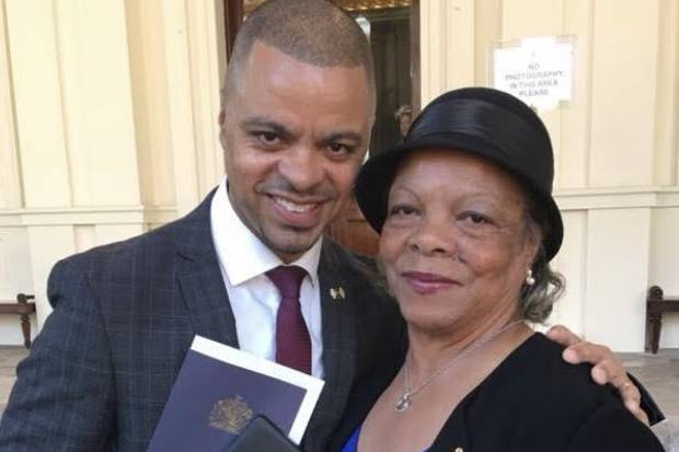 Rob Neil with his mother at Buckingham Palace after receiving his OBE