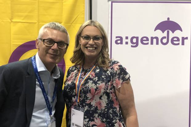 Jonathan Slater with Emma Dunn, Chair of a:gender, alongside a banner displaying the a:gender logo
