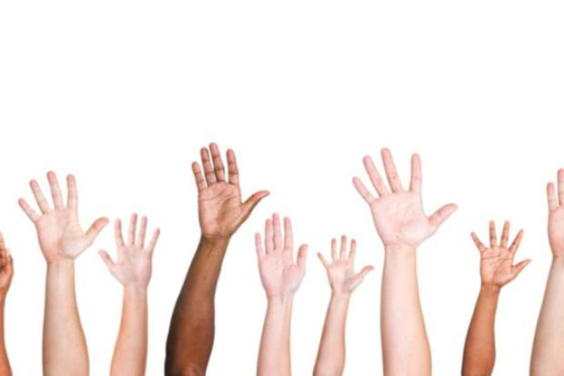 Image of raised hands and arms belonging to a diverse group of people