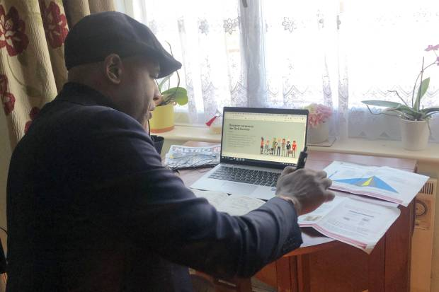 Brian Stanislas at his desk, working from home