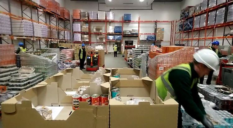 Boxes of essential supplies were packed at locations across the nation to get supplies to the needy