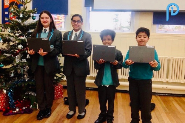 Children with Chromebook devices with Inside Policy logo