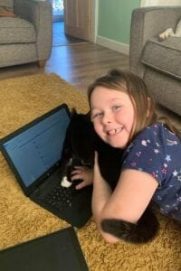 Pupil at Green Way Academy trying out her new laptop