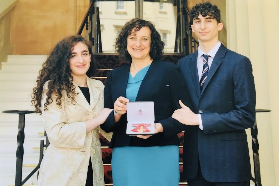 Stephanie Karpetas OBE receiving her honour at Buckingham Palace